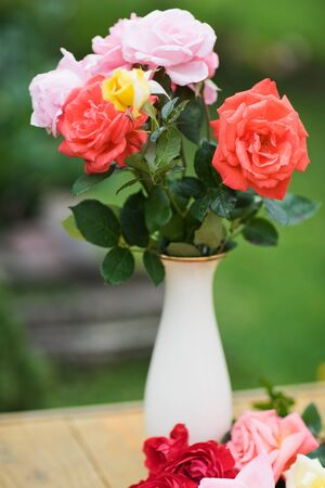 Bouquet of roses in porcelain vase photo