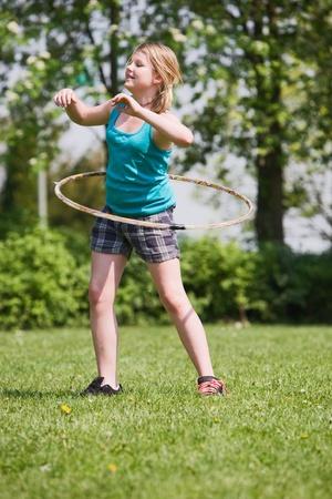 Young girl practising a hula hoop