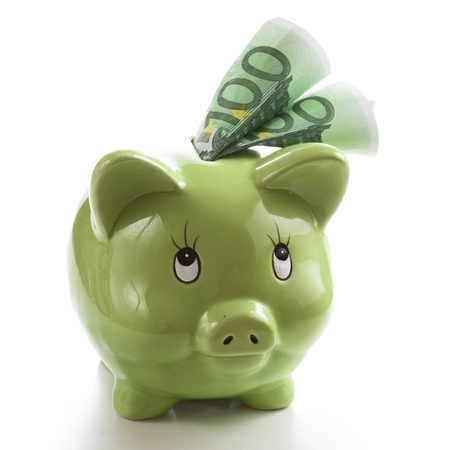 euro's: Two hundred Euros in a green piggy bank