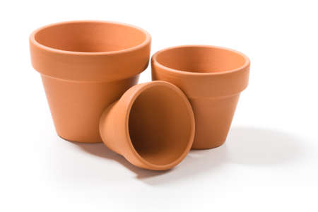 Three terracotta flower pots on white