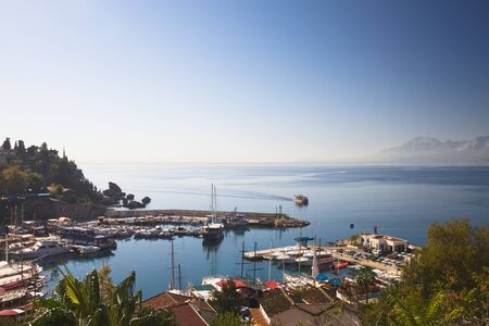 Turkey, Antalya, marina and rooftops of Old Town  Stock Photo