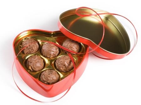 Heart shaped chocolates on white background photo