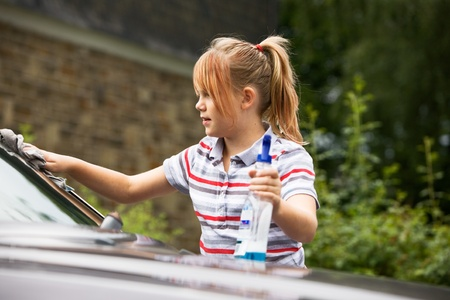 Portrait of young girl washing car Stock Photo - 9661466