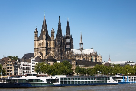 Great St Martin Church and Cologne Cathedral, big excursion ship in the forefront, Cologne, North Rhine-Westphalia, Germany