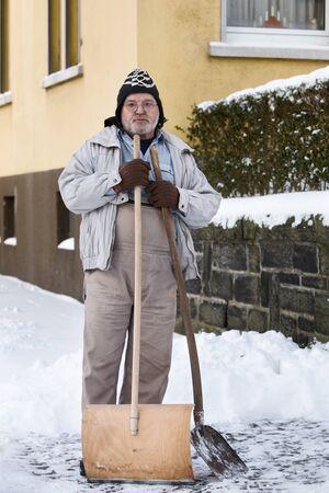 Senior Man Standing with Snow Shovel Stock Photo - 10029521