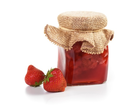 jam: Jar of strawberry jam to give as a gift and fresh strawberries on white
