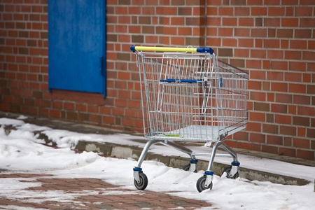 Abandoned Shopping Cart in Snow photo
