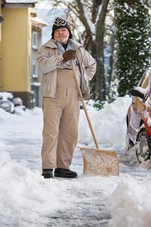 Senior Man Standing with Snow Shovel Stock Photo - 10103678