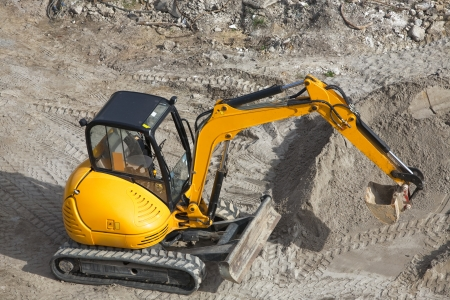 High angle view of yellow mini excavator