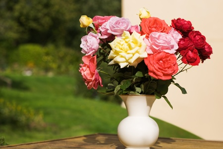 Porcelain pot with colorful roses photo