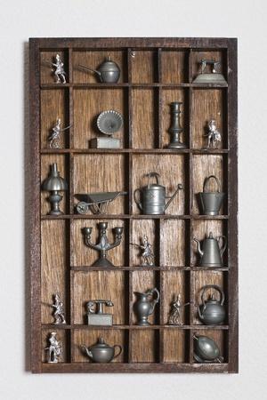 Wooden shelf with tin miniatures  photo