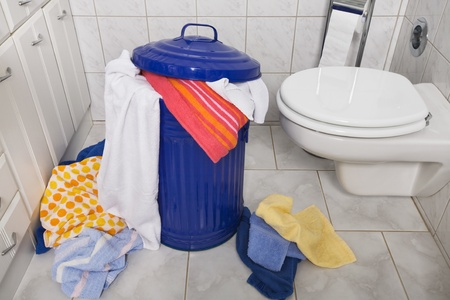 Blue laundry container in domestic bathroom photo