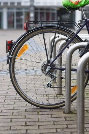 rack wheel: Bicycle parked in a parking lot Stock Photo