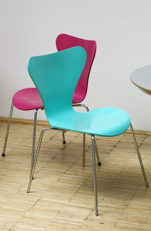 anteroom: Pink and cyan chairs in waiting room Stock Photo