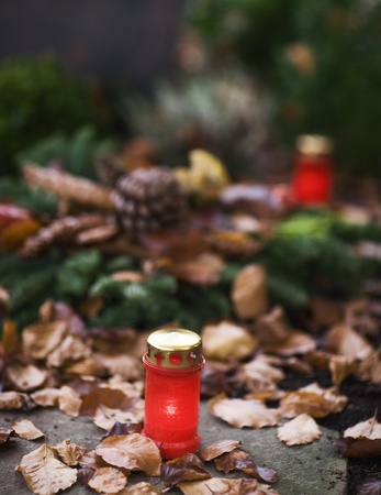 Red candle lantern on the grave photo