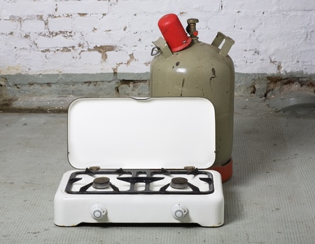 Vintage gas stove and propane bottle in the cellar Stock Photo - 10386350