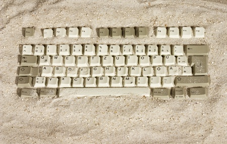 Vacation with computer keyboard on the beach