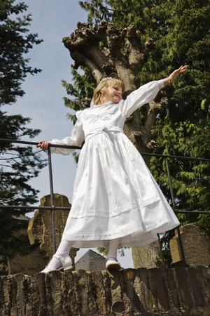 Young girl in her white communion dress photo