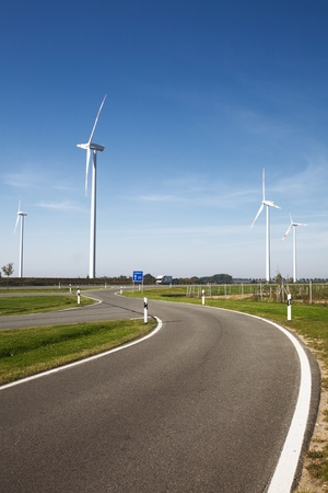 Modern landscape with wind turbines and highway, North Germany photo