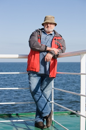 Senior man standing on ship deck Stock Photo - 10924245