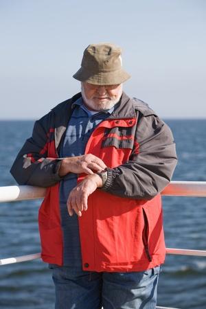 Senior man checking the time Stock Photo - 10924244