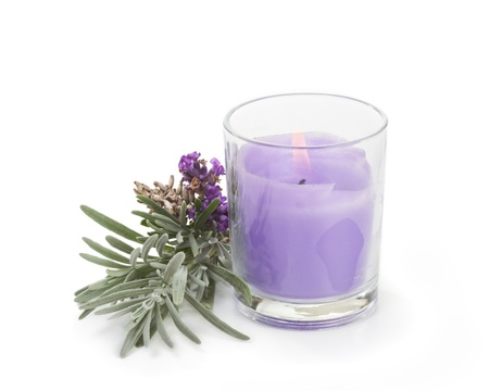 Lavender candle with fresh lavender on white
