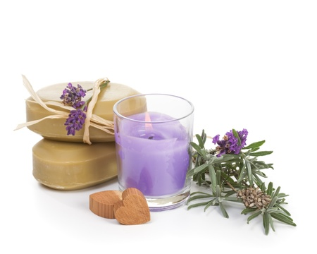Fresh lavender, lavender candle, lavender soap and cedar moth hearts on white background