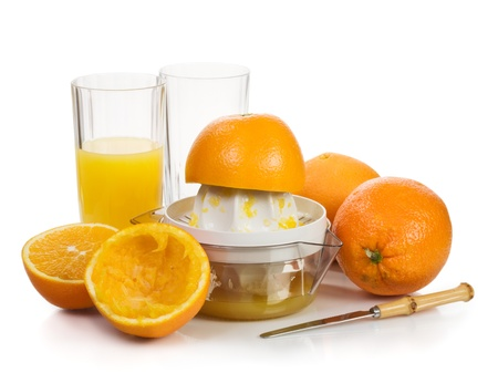 squeeze: Orange juice with squeezed fruit on white background