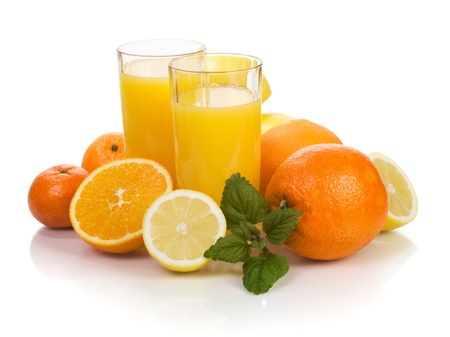 Citrus fruits and two glasses of fresh orange juice photo
