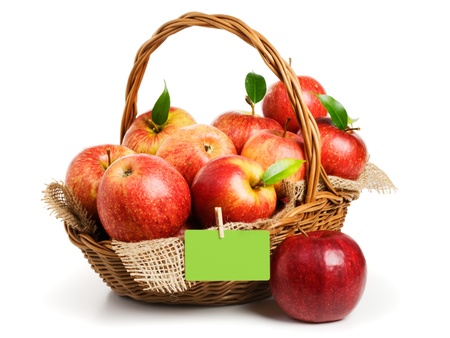 Jonagold apples in a basket with empty card on white background photo