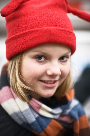 Portrait of girl wearing red knit hat photo