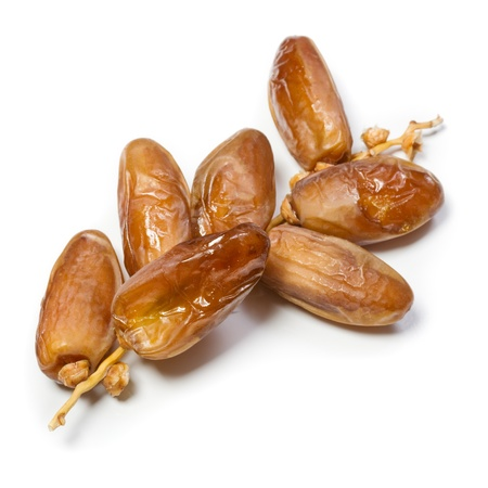Dried dates on stalk, white background Stock Photo