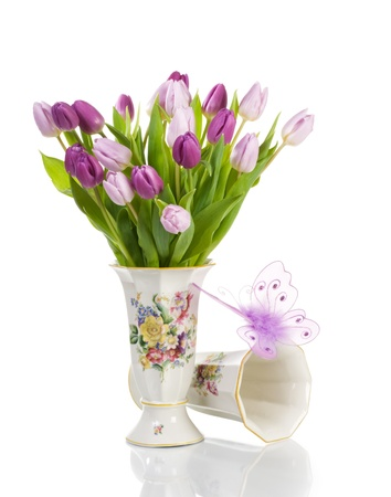 Two antique porcelain vases with tulips and butterfly on white background photo