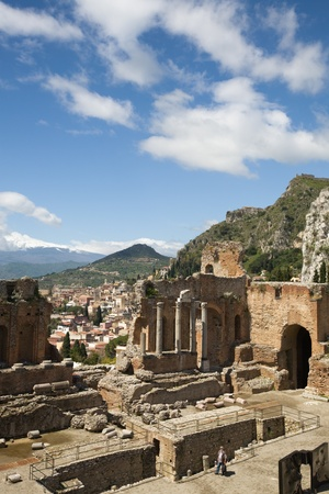 taormina: The Greek theatre with Mount Etna behind, Taormina, Messina Province, Sicily, Italy