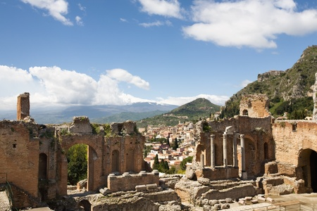 taormina: Ruins of the Greek Theatre in Taormina with Etna beyond, Sicily, Italy