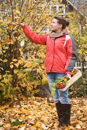 girl boots: Teenage girl in golden fall foliage