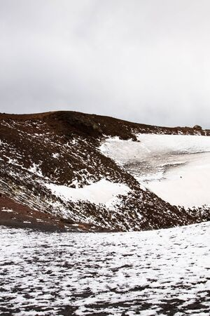 volcano slope: Lava rocks with snow on volcano slope of Etna, Sicily, Italy