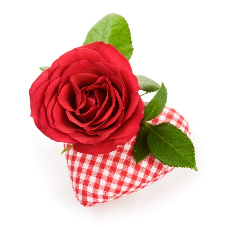 Single red rose with fabric heart on white photo
