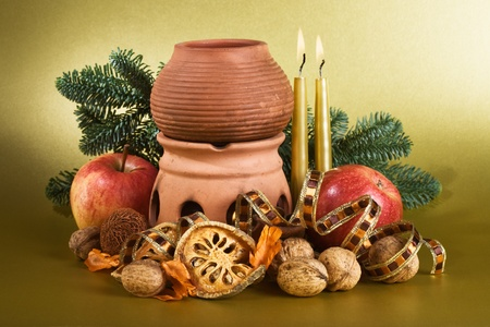 Christmas arrangement with aroma lamp on gold background photo