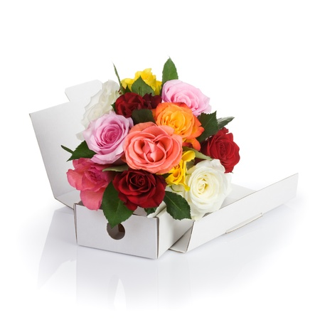 White cardboard box of fresh roses on white background photo