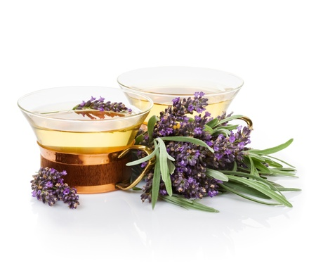 Two cups of lavender tea and bunch of fresh lavender on white background