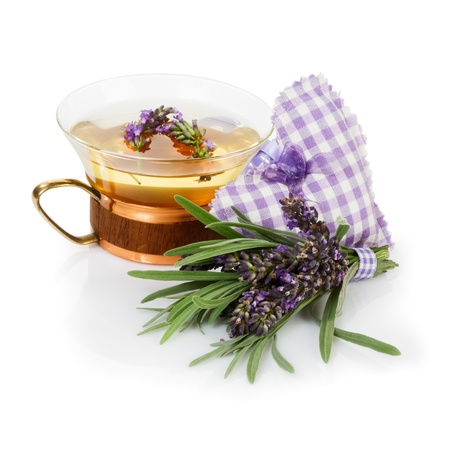 Lavender tea and bunch of fresh lavender on white background