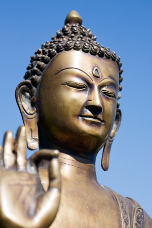 Close-up of a Buddha sculpture with fingers  photo
