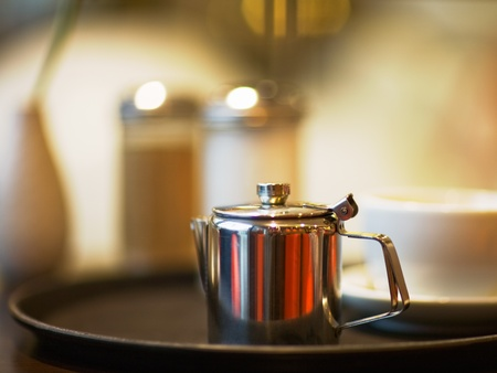 Silver coffee pot on table, selective focus  photo