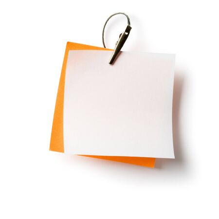White and orange notepads with crocodile clip on white Stock Photo - 16640828