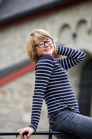 Portrait of girl wearing fashionable eyeglasses with retro frames photo