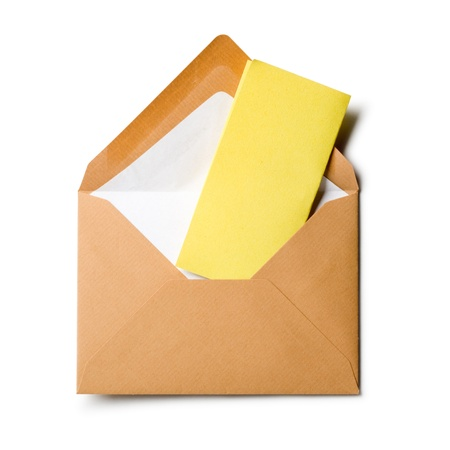 Open envelope with yellow notepad on white background Stock Photo - 16640835