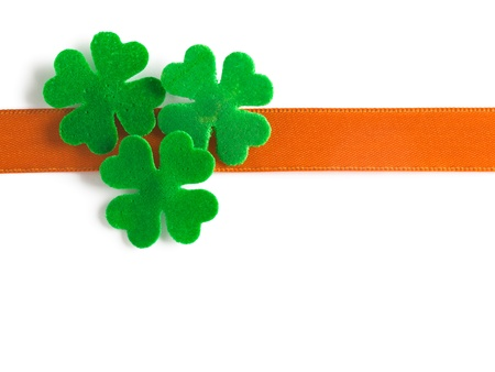 Lucky four leaf clover and bow for Patricks Day clipping path included Stock Photo - 17077511