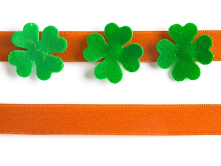Green clovers with orange bow for Patricks Day Stock Photo - 17077518