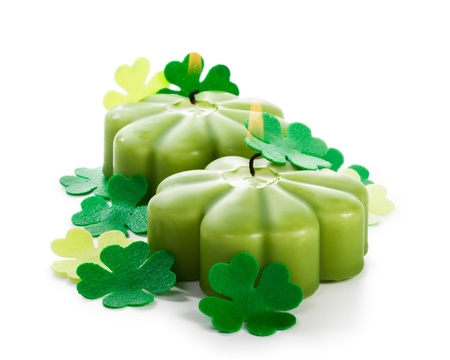 Two shamrock burning candles for Patricks Day clipping path included Stock Photo - 17077464